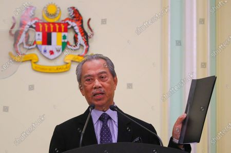 Malaysia's new Prime Minister Muhyiddin Yassin shows documents during press conference at Prime Minister Office is Putrajaya, outside Kuala Lumpur, Malaysia, 09 March 2020.  Muhyiddin Yassin announce his ministers today after the Yang di-Pertuan Agong (ruling monarch of Malaysia) Abdullah of Pahang named Muhyiddin the country's new premier on 29 February 2020 following the resignation of his predecessor, 94-year-old Mahathir Mohamad, a week earlier.