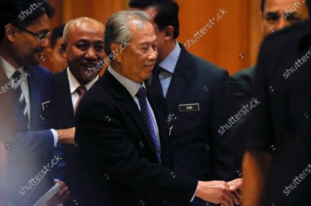 Malaysia's new Prime Minister Muhyiddin Yassin arrives at the Prime Minister's Office in Putrajaya, outside Kuala Lumpur, Malaysia, 09 March 2020. Muhyiddin Yassin announce his ministers today after the Yang di-Pertuan Agong (ruling monarch of Malaysia) Abdullah of Pahang named Muhyiddin the country's new premier on 29 February 2020 following the resignation of his predecessor, 94-year-old Mahathir Mohamad, a week earlier.