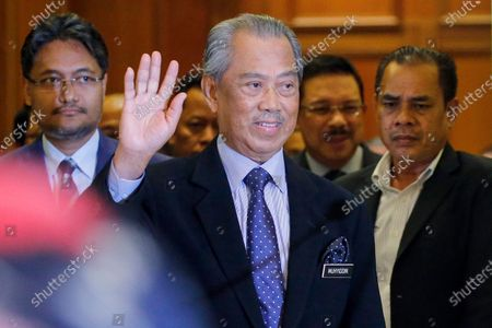 Stock Photo of Malaysia's new Prime Minister Muhyiddin Yassin arrives at the Prime Minister's Office in Putrajaya, outside Kuala Lumpur, Malaysia, 09 March 2020. Muhyiddin Yassin announce his ministers today after the Yang di-Pertuan Agong (ruling monarch of Malaysia) Abdullah of Pahang named Muhyiddin the country's new premier on 29 February 2020 following the resignation of his predecessor, 94-year-old Mahathir Mohamad, a week earlier.