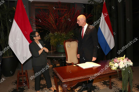 Stef Blok, Retno Marsudi. Netherlands' Foreign Minister Stef Blok, right, talks with his Indonesian counterpart Retno Marsudi prior to their meeting in Jakarta, Indonesia
