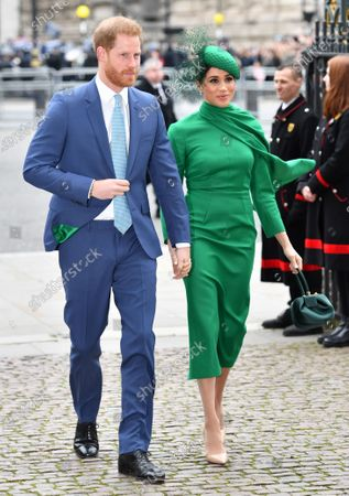 Prince Harry and Meghan Duchess of Sussex. The lining of Harry's jacket matched Meghan's dress