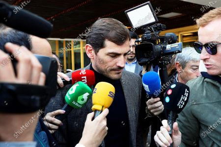 Spanish goalkeeper Iker Casillas (C) is surrounded by journalists as he leaves the Spanish Higher Sports Council (CSD) in Madrid, Spain, 09 March 2020. Casillas met CSD president Irene Lozano after he announced his intention to run for the presidency of the Royal Spanish Soccer Federation (RFEF).
