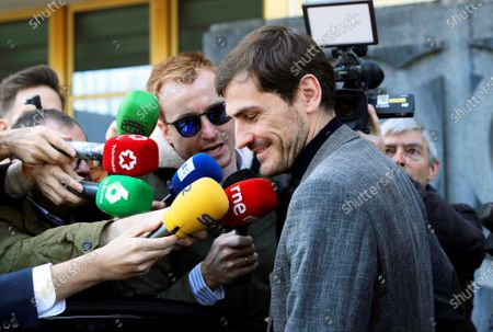 Spanish goalkeeper Iker Casillas (front) is surrounded by journalists as he leaves the Spanish Higher Sports Council (CSD) in Madrid, Spain, 09 March 2020. Casillas met CSD president Irene Lozano after he announced his intention to run for the presidency of the Royal Spanish Soccer Federation (RFEF).