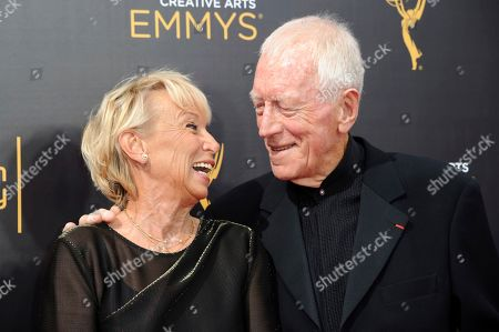 """Catherine Brelet, Max von Sydow. Max von Sydow and his wife Catherine Brelet, left, arrive at night one of the Creative Arts Emmy Awards at the Microsoft Theater in Los Angeles..Max von Sydow, the self-described """"shy boy""""-turned-actor who played the priest in the horror classic """"The Exorcist,"""" has died, it was reported on Monday, March 9, 2020. He was 90. He was known to art house audiences through his work with Swedish director Ingmar Bergman. But it was his role as the devil-evicting priest in William Friedkin's controversial 1973 film """"The Exorcist"""" that brought him to international attention"""