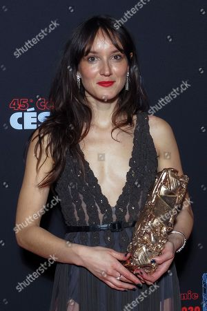 Stock Picture of Anais Demoustier poses with the Best Actress award for the movie 'Alice et le Maire'