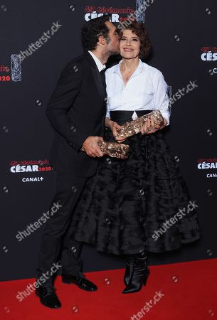 Nicolas Bedos and Fanny Ardant pose with their trophies respectively Best Original Screenplay award and Best Actress in a Supporting Role award for the movie 'La Belle epoque'
