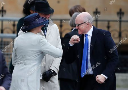 United States Ambassador to the United Kingdom Woody Johnson, right, greets by bumping elbows as he arrives to attend the annual Commonwealth Day service at Westminster Abbey in London, . The annual service organised by the Royal Commonwealth Society, is the largest annual inter-faith gathering in the United Kingdom