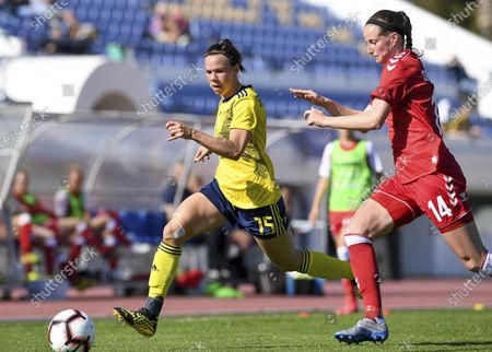 Stock Picture of Swedish Jessica Samuelsson (15) pictured with Danish midfielder Nicoline Soerensen (14)
