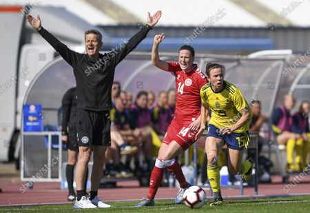 Stock Photo of Danish head coach Lars Sondergaard pictured with Danish midfielder Nicoline Soerensen (14) and Swedish Jessica Samuelsson (15)