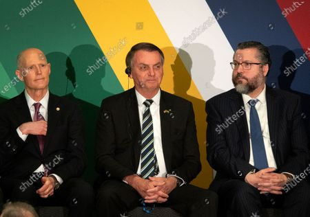 Brazilian President Jair Bolsonaro (C) sits next to Republican US Senator from Florida Rick Scott (L) and Brazilian Foreign Affairs Minister Ernesto Araujo during the opening session of the Brazil-United States Business Relations Seminar at the Hilton Miami Downtown hotel in Miami, Florida, USA, 09 March 2020.
