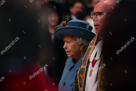 Queen Elizabeth II (L) and The Very Reverend Dr David Hoyle, The Very Reverend John Hall (R) attend the annual Commonwealth Service at Westminster Abbey in London