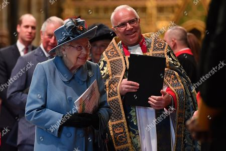 Queen Elizabeth II is introduced to performers by by The Very Reverend Dr David Hoyle, The Very Reverend John Hall, as she leaves after attending the annual Commonwealth Service at Westminster Abbey in London