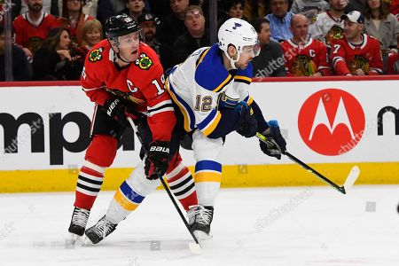 Jonathan Toews, Zach Sanford. Chicago Blackhawks center Jonathan Toews (19) and St. Louis Blues left wing Zach Sanford (12) during the first period of an NHL Hockey game, in Chicago