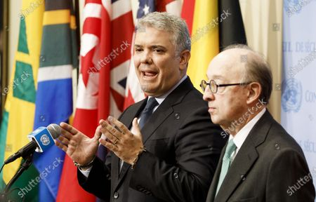 Stock Image of Colombia's President Ivan Duque Marquez (L) talks with the press following a meeting with United Nations Secretary-General Antonio Guterres at United Nations headquarters in New York, New York, USA, 09 March 2020. At right is Colombia's Ambassador to the United Nations Guillermo Fernández de Soto.