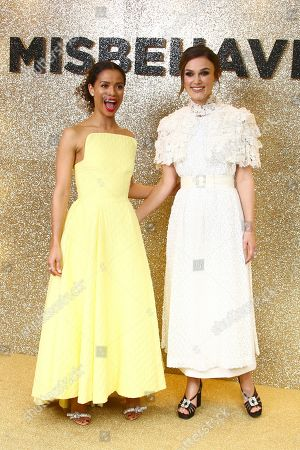 Keira Knightley, Gugu Mbatha-Raw. Actors Gugu Mbatha-Raw, left and Keira Knightley pose for photographers upon arrival at the World Premiere of 'Misbehaviour' at a central London hotel