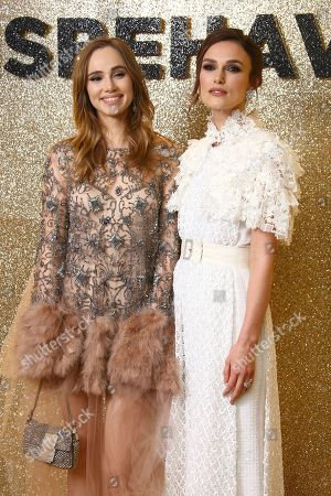 Keira Knightley, Suki Waterhouse. Actors Suki Waterhouse, left and Keira Knightley pose for photographers upon arrival at the World Premiere of 'Misbehaviour' at a central London hotel