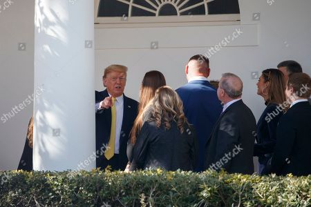 Donald Trump, Brian Urlacher. President Donald Trump talks with people on the colonnade, including Chicago Bears and Hall of Fame linebacker Brian Urlacher, fourth from left, after arriving at the White House in Washington, Monday, March, 9, 2020. The president is returning from Florida