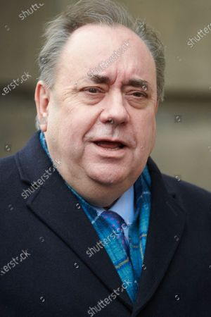 Former Scottish First Minister Alex Salmond emerges from Edinburgh's High Court on the first day of his trial on charges of sexual assault and attempted rape.