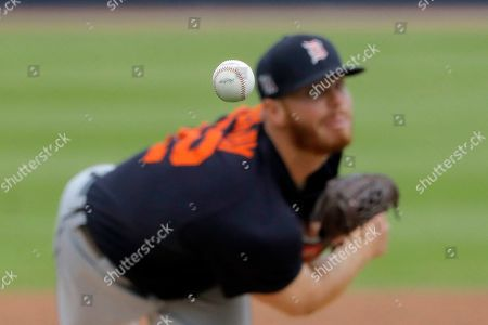 Detroit Tigers pitcher David McKay throws a pitch to the Houston Astros during the fourth inning of a spring training baseball game, in West Palm Beach, Fla