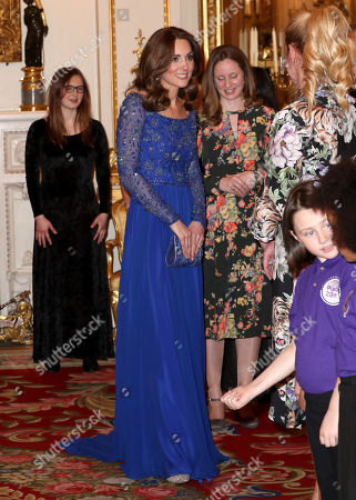 Stock Image of Catherine Duchess of Cambridge speaks with a school choir as she hosts a Gala Dinner in celebration of the 25th anniversary of Place2Be at Buckingham Palace.