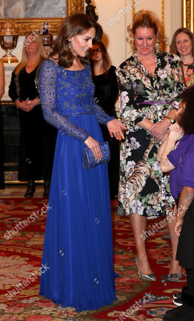 Catherine Duchess of Cambridge speaks with a school choir as she hosts a Gala Dinner in celebration of the 25th anniversary of Place2Be at Buckingham Palace.