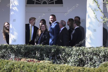 Stock Image of US President Donald J. Trump (2-L) talks to a group of visitors and former Chicago Bears linebacker, Brian Urlacher (C) at the Colonnade of the White House as they watch the Marine Helicopter Squadron One departing from the South Lawn in Washington, DC, USA, 09 March 2020. Trump spent a weekend in FL.