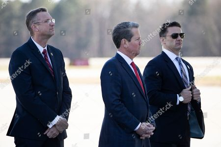 Doug Collins, Brian Kemp. Rep. Doug Collins, R-Ga., left, waits with Gov. Brian Kemp, R-Ga., and a U.S. Secret Service Special Agent for President Donald Trump to step off Air Force One during arrival, at Dobbins Air Reserve Base in Marietta, Ga