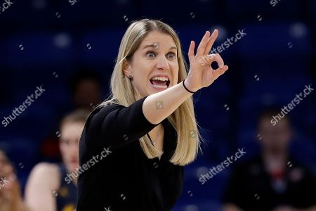Marquette head coach Megan Duffy signals during the second half of an NCAA college basketball game against DePaul in the Big East women's tournament final, in Chicago