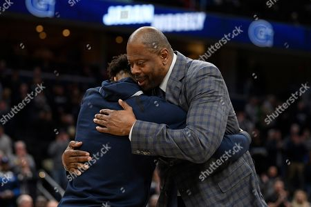 Georgetown guard Jagan Mosely, left, and head coach Patrick Ewing, right, react during senior day festivities before an NCAA college basketball game against Villanova, in Washington