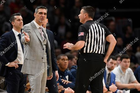 Villanova head coach Jay Wright gestures to an official during the second half of an NCAA college basketball game against Georgetown, in Washington. Villanova won 70-69
