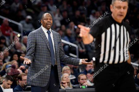 Georgetown head coach Patrick Ewing gestures during the second half of an NCAA college basketball game against Villanova, in Washington. Villanova won 70-69