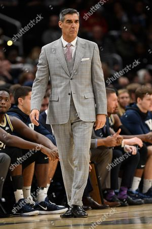 Villanova head coach Jay Wright stands on the court during the first half of an NCAA college basketball game against Georgetown, in Washington