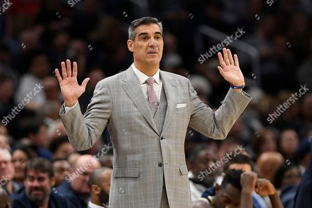 Villanova head coach Jay Wright gestures during the second half of an NCAA college basketball game against Georgetown, in Washington. Villanova won 70-69