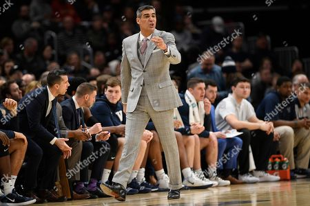 Villanova head coach Jay Wright gestures during the first half of an NCAA college basketball game against Georgetown, in Washington