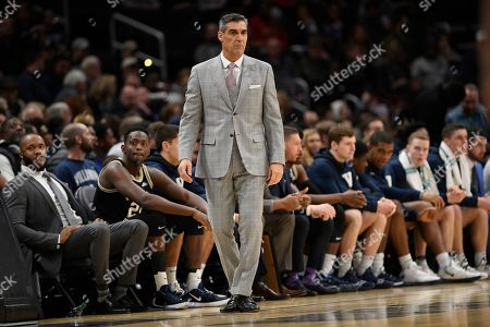 Stock Image of Villanova head coach Jay Wright stands on the court during the first half of an NCAA college basketball game against Georgetown, in Washington