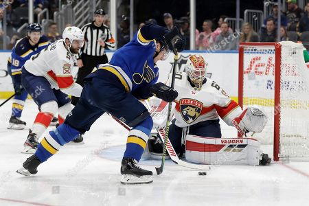 St. Louis Blues' Alexander Steen, center, is unable to score past Florida Panthers goaltender Chris Driedger, right, as Panthers' Aaron Ekblad, left, watches during the second period of an NHL hockey game, in St. Louis