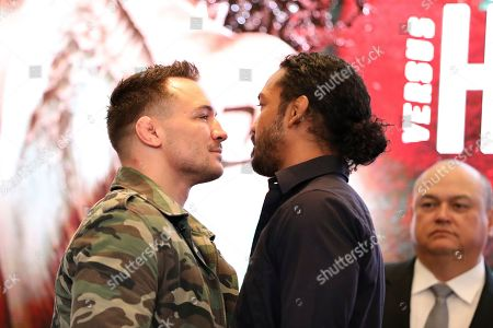 Stock Picture of Michael Chandler, left, squares off with Benson Henderson at a news conference promoting the Bellator Spring & Summer fight cards, in New York City