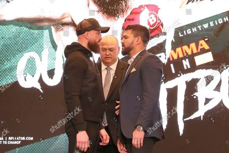 Peter Queally, left, and Patricky 'Pitbull' Freire square off at a news conference promoting the Bellator Spring & Summer fight cards, in New York City