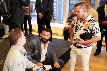 Eric Albarracin and Patricio 'Pitbull' Freire speak to the media a news conference promoting the Bellator Spring & Summer fight cards, in New York City