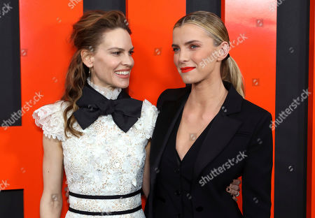 """Hilary Swank, Betty Gilpin. Hilary Swank, left, and Betty Gilpin arrive at the LA Special Screening of """"The Hunt,"""" at the ArcLight Hollywood, in Los Angeles"""
