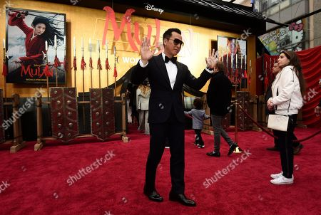 """Donnie Yen, a cast member in """"Mulan,"""" poses at the premiere of the film at the El Capitan Theatre, in Los Angeles"""