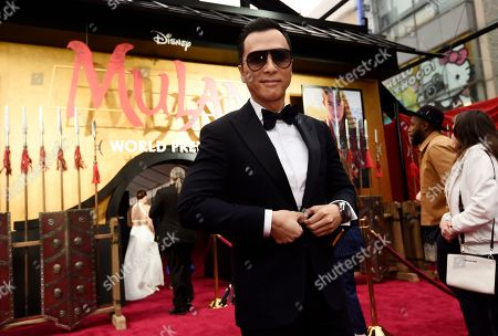 """Donnie Yen, a cast member in the new live-action """"Mulan,"""" poses at the premiere of the film at the El Capitan Theatre, in Los Angeles"""