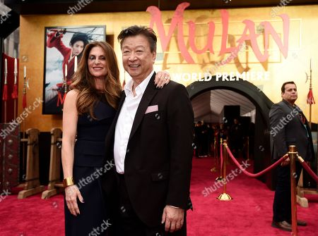 """Niki Caro, Tzi Ma. Niki Caro, left, director of the new live-action """"Mulan,"""" poses with cast member Tzi Ma at the premiere of the film at the El Capitan Theatre, in Los Angeles"""