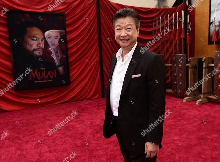 """Tzi Ma, a cast member in the new live-action """"Mulan,"""" poses at the premiere of the film at the El Capitan Theatre, in Los Angeles"""