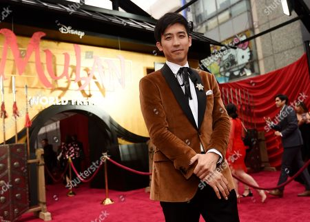 """Jimmy Wong, a cast member in the new live-action """"Mulan,"""" poses at the premiere of the film at the El Capitan Theatre, in Los Angeles"""
