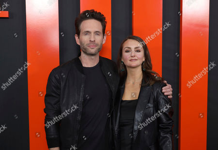 """Stock Image of Glenn Howerton, Sylvia Grace Crim. Glenn Howerton, left, and Sylvia Grace Crim arrive at the LA Special Screening of """"The Hunt"""" at the ArcLight Hollywood on in Los Angeles"""