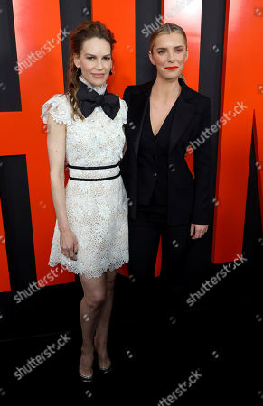 """Hilary Swank, Betty Gilpin. Hilary Swank, left, and Betty Gilpin arrive at the LA Special Screening of """"The Hunt"""" at the ArcLight Hollywood on in Los Angeles"""
