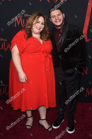 """Hal Rosenfeld, Chrissy Metz. Chrissy Metz, left, and Hal Rosenfeld arrive at the Los Angeles premiere of """"Mulan"""" at the Dolby Theatre on"""