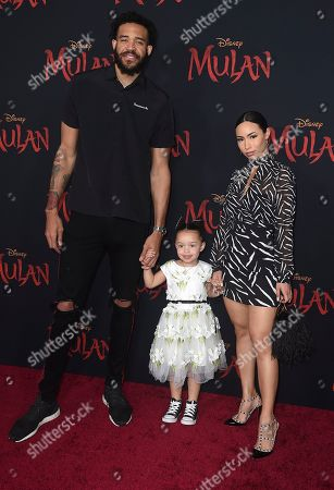 """From left, JaVale McGee, Giselle Mybelle and their daughter arrive at the Los Angeles premiere of """"Mulan"""" at the Dolby Theatre on"""