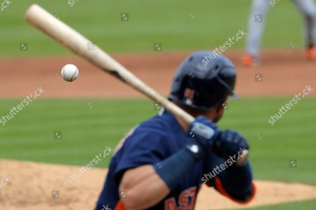 Stock Image of A pitch from Detroit Tigers pitcher David McKay makes its way to Houston Astros batter Lorenzo Quintana during the fourth inning of a spring training baseball game, in West Palm Beach, Fla
